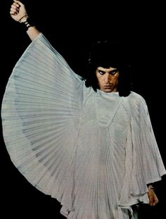 Freddie Mercury wearing his stage costume designed by Zandra Rhodes, photo by Mick Rock 1974.