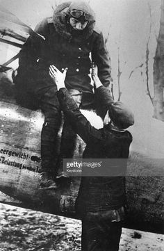 Baron Manfred von Richthofen (1882 - 1918), the infamous 'Red Baron', Commander of the 11th Chasing Squadron in the First World War, is assisted from his Albatross Bi-plane after a reconnaissance flight over the Western Front. Original Publication: People Disc - HM0377