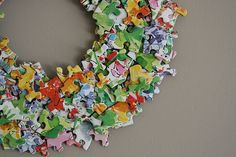 DIY Puzzle Wreath - cute for my classroom door. (Use styrofoam cut in half) Puzzle Piece Crafts, Puzzle Art, Puzzle Pieces, Wreath Crafts, Diy Wreath, Diy Crafts, Puzzle Jewelry, Friends Of The Library, Crafts For Kids
