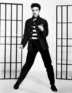 Black-and-white promotional photograph of Elvis Presley from the 1957 film Jailhouse Rock. American singer Elvis Presley featured in the decade-end singles chart with four songs. Lisa Marie Presley, Priscilla Presley, Elvis Presley Facts, John Lennon, Debbie Harry, Graceland, Freddie Mercury, Bob Marley, Rock N Roll