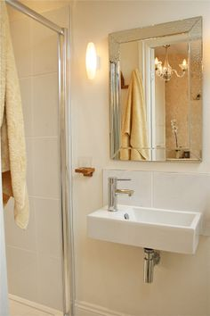 Project Squeeze. One bed rental apartment with small shower room. Cream, limestone and pale gold interiors scheme.