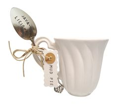 2-piece set includes fluted ceramic mug and stamped coffee spoons