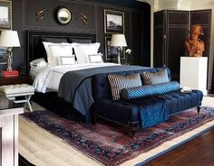 I love the masculine, strong design here. Rich dark walls are so soothing for a bedroom.