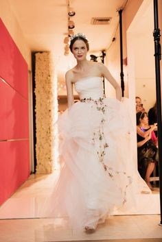 We've already seen hemlines rising in the ready-to-wear circles for spring 2015, and now crop tops have infiltrated Bridal Fashion Week as well. Reem Acra's delicately beaded version is for a bold bride with a killer bod. This look featured a matching skirt with a high crest in the front so as not to appear gauche and show off one's belly button. As you can see here, the ensemble works well within a collection that was clearly aimed at bohemian brides with luxurious taste.