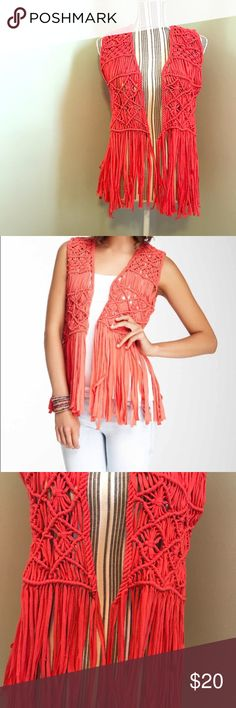 Boho Crochet Fringe Vest In EUC! I only wore it twice! Just didn't really have the right thing to wear it with. Machine washed gentle cycle and hung to dry. Perfect to layer with! It is a coral/orange color! No tags attached so I am unsure of name brand or material content. Fits a size S/M- measurements upon request! The material of the vest is like a jersey Knit material. Hangs open. Perfect for a boho look! Feel free to make an offer- from a clean and smoke free home! Jackets & Coats Vests