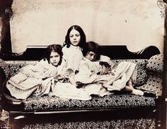 Snapshot: A photograph taken by Lewis Carroll of Alice Liddell (R), his