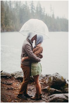 Engagement photos taken in the rain  at Lost Lake in the winter on Mt. Hood. Photos by Katy Weaver