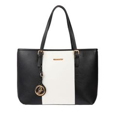 Sac cabas de grande contenance porté épaule noir et blalnc. #sac #bag #tendance #mode #fashion #élégance #cuir #grandsac #noiretblanc #lamodeuse