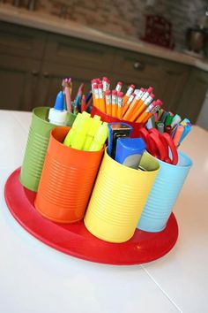 Reuse cans for craft supplies. Paint them fun colours or use chalkboard paint to label them.