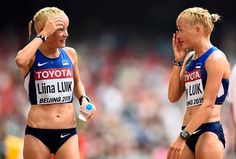 World Athletics Championships 2015: day nine – in pictures   Sport   Estonia's Liina Luik talks to her twin sister Lily after the women's marathon