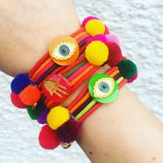 ✋ & repeat ... our #danalevy neon evil eye & hamsa hand lucky charm pompom friendship bracelets are perfect for stacking ✋✋