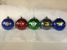 2012 Super Hero Ornaments - use flat ornaments instead of ball and use avery labels, great advice