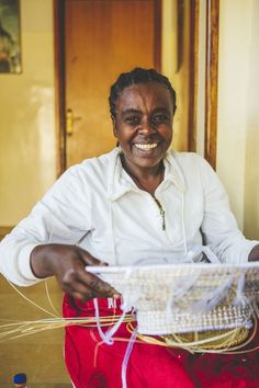 """""""I've been working here for four years and this is where I learnt how to make baskets. I also make some income doing laundry for other people. With both these jobs, I can make ends meet."""" says Fantanesh, an artisan from Ethiopia ©️️ ITC Ethical Fashion Initiative & Louis Nderi"""