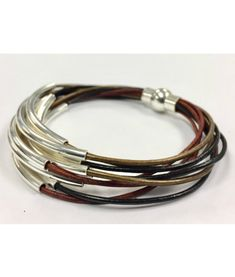 Leather cords in black, red brown and bronze lend an earthy look to this boho chic bracelet. It has 8 strands of round leather cords accented with moveable silv Leather Cord Bracelets, Ankle Bracelets, Leather Jewelry, Silver Jewelry, Beaded Bracelets, Silver Ring, Silver Bracelets, Silver Earrings, Strand Bracelet