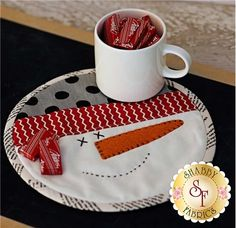 "Your table will be ready for the winter with this adorable mug mat! 8"" in diameter, it is the perfect size to rest a warm tasty drink or treat, while protecting the surface underneath."