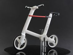 ronen spector: spine city bike with built-in lock.  The red bar detaches to become a flexible bike lock.