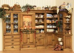 Kitchen cupboards beautifully decorated with dollhouse miniatures