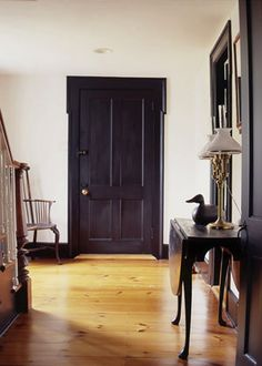 If you want to give a crisp modern counterpoint to your country deco, try painting the trim and doors black.  Bold and beautiful!