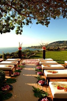 Love the green palm leaves and floral next to the cushioned seats down the aisle. Great sub for rose petals.