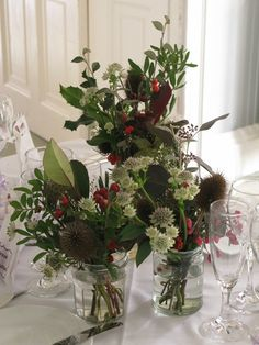 Beautiful floral arrangements from an autumn hedgerow inspired wedding with rosehips, teasels and old man's beard | The Natural Wedding Company