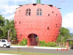 a strawberry house! apparently, it's in Brazil.