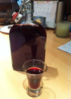 Homemade blackberry gin-- perfect use for those wild blackberries behind my house...!