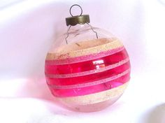 This vintage, unsilvered Christmas ornament was made in the USA. The large glass holiday ornament a pink glazed section around the middle