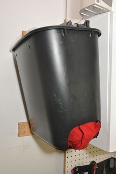 Use a small trash can inside utility closet for rags