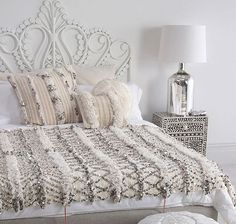 A sparkly Moroccan wedding blanket on the bed? Yes, please!