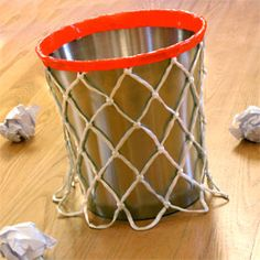 orange tape and a real basketball net over the trashcan.might as well go ahead and make it. For a kid's bedroom - big or little!
