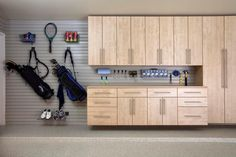 Floating lower cabinetry so the garage floors can still be washed down, great idea!