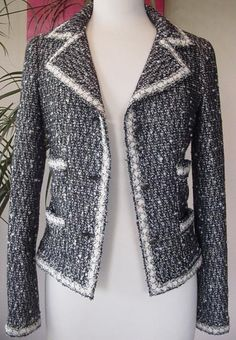 Chanel fantasy black tweed jacket. I need this for New Years, over a hot dress.