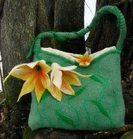 The embroidery really adds something to this knit bag with felt flower