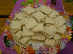 Tropical Krispie Treats: Krisped Rice Cereal Treats made with Coconut Oil and frosted with White Chocolate and topped with Coconut and White Jimmies.
