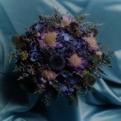 Bouquet of shades of blue mixed flowers.