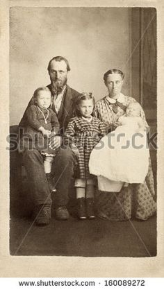 CIRCA 1860 - A vintage Cartes de visite photo of a pioneer family of five. The mother and father are sitting with their three young daughters. A photo from the Civil War era. A digital copy of this photo can be purchased at the above web link.