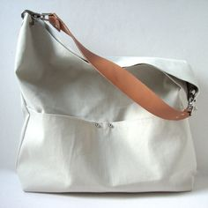 This Bucket Tote Bag found on Obaz.com is beautious. Definitely don't need it for $114.00. Might start buying leather and making bags myself. any suggestions on how to start that?