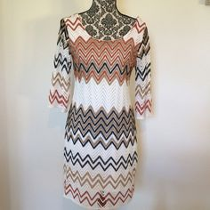 """Chevron Knit Dress Cute dress with Chevron pattern. Sheer 3/4 length sleeves. Looks adorable for summer!  Size Petite Medium, but fits like a normal Medium.   Size PM Bust 36, Length 37""""  Lined  100% polyester  Previously owned, still in great condition - no signs of wear Fresh of LA Dresses"""