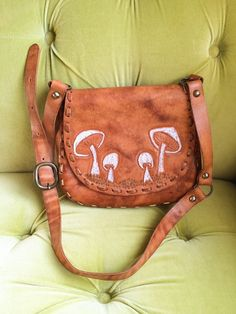 A personal favorite from my Etsy shop https://www.etsy.com/listing/216847158/vintage-tooled-leather-handbag-brown