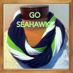 Support Russell and the boys.  This scarf is also available with gray trim rather than white see https://www.etsy.com/listing/162631367/seattle-seahawks-12th-man-t-shirt-scarf?   Enjoy wearing your favorite color combo of recycled t shirt knit. It is a classic blend of Seahawks colors ready for Football .  This scarf tubes are not attached and can be worn many different ways. See photos 2-4  A warm snuggley neck warmer at those cold outdoor games or a loose fashion accessory at a house party…