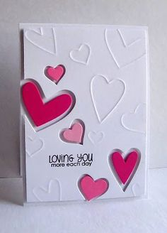 Blogger die cut the hearts and then used the same hearts to emboss the card before popping it up and adding the die cuts.  SSS heart dies
