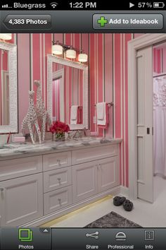 If my girls share a bathroom in our next home, this would be a fun way to decorate it.  Love it!