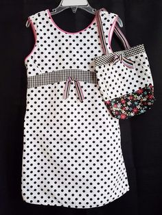 Really cute girls dress size 6. It has a cute little cloth purse that matches dress that comes with it. It is white with black polka dots.Your chance to still get a Patsy Aiken design since she has retired.   eBay!