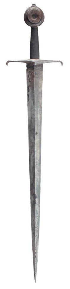 A late Medieval Knightly sword from the end of the Hundred Years' War, circa 1450. In excavated condition, with short blade sharply tapering from a broad base, of flattened diamond section and struck with a mark on both sides at the forte, faceted crosspiece tapering from a broad centre and the tips abruptly downturned, large wheel pommel with recessed centre, facetted tang button, and later grip . L. overall: 88 cm - L. blade: 71 cm - W.: 17 cm.