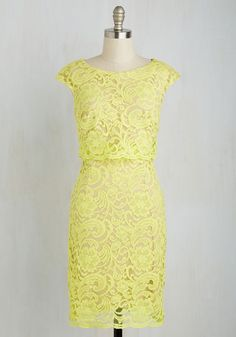 You look equal parts zesty and sweet in this lemon yellow shift dress, and when your main squeeze sees the chic way you look, you're sure to receive a hug! Mixing a popover bodice, a sheer lace overlay, and beige lining with your stunning smile, this frock makes for a refreshingly ravishing style.