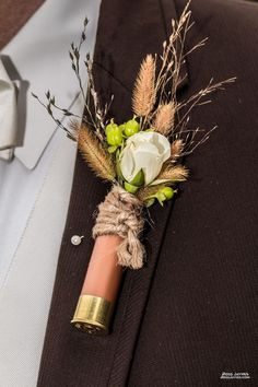 Clemmie Grace Designs, Columbia, Tennessee.  Shotgun shell boutineer.  Rustic.  Wedding.
