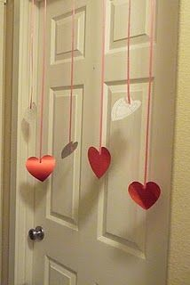 Put up a heart curtain while kids are sleeping...they will be so excited to open their door to it on Valentine's Day morning
