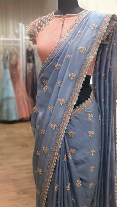 EDHAS- every dress has a story! Designer boutique in MVP colony Contact us - 08912786788 . Grey over coat embellished with crystals,… Trendy Sarees, Stylish Sarees, Fancy Sarees, Party Wear Sarees, Saree Blouse Patterns, Sari Blouse Designs, Red Lehenga, Lehenga Choli, Anarkali