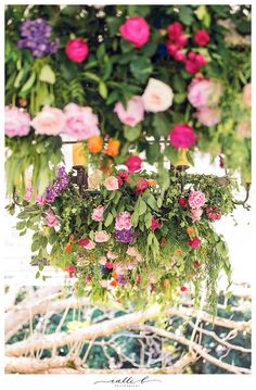 Chandeliers with hanging bright boho flowers and greenery