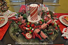 Christmas table scape! Love the candy cane candle!!